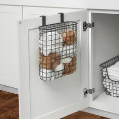 """This Towel Bar and Basket Cabinet Door Organizer conquer kitchen and bathroom clutter while providing unique cabinet storage solutions. Padded foam brackets easily slide over standard cabinet doors without any tools or installation. The towel bar accommodates hand and dish towels while the basket keeps household items up to 10"""" tall neatly contained. It's also perfect for the laundry room. Features Maximize your cabinet capacity by taking advantage of unused space Padded brackets help .."""