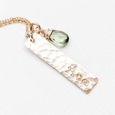 Our personalized Mother's necklace features a name hand stamped into a hammered vertical bar and includes a wire wrapped natural birthstone with each tag charm. Unique and thoughtful, makes a perfect gift for a new Mom to capture a Baby's name, or add more tags for a Mom of 1,2,3 or 4 kids. Makes a thoughtful gift idea for Mother's Day or Christmas. Or buy one for yourself! Family Necklace, Name Necklace, Vertical Bar, 4 Kids, Personalized Jewelry, Baby Names, Hand Stamped, Pink And Gold, Birthstones