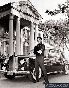 The King - Elvis Presley posing in front of his Rolls Royce Silver Cloud and his castle - Graceland