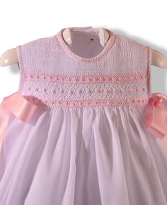 Sweet pink summer dress smocked on white batiste.  Love the feather stitching on collar and sleeve bands.