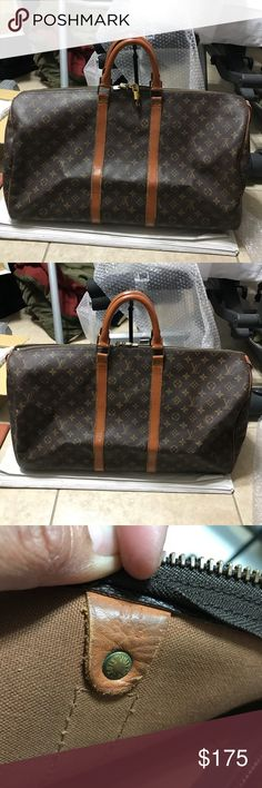 Louis Vuitton Keepall 55 Monogram 100% Authentic Louis Vuitton Travel Bag Keepall 55, Fair condition,,,stains , crackson vachetta but rhas been painted.. canvas also has been repaired but still functional .. comes with lock and key Louis Vuitton Bags Travel Bags