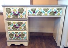 Upcycled desk with mod podge fabric drawers.