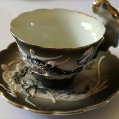 1900 - 1925's Small Chinese Dragon Cup & Saucer Cup has small chip  Dimensions Cup +/- .  65 x 75 x 78 (mm) :  2,60 x 2,96 x 3,07 (inch) Weight Cup +/- .  38 g :  1,34 ounces Dimensions Saucer +/- .  85 x 85 x 10   3,35 x 3,35 x 0,39 (inch)
