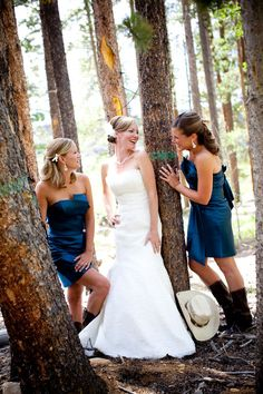 Moment between bride and bridesmaids.  Photo by Susan Pacek Photography.