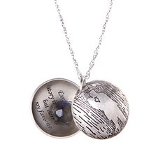 """This """"Love Story"""" locket by Britta Ambauen Jewelry is a truly special necklace that features one-of-a-kind details and is one of the most unique gifts you can give. Made of high-quality sterling silver, the pendant is inscribed on the inside with """"Every love story is unique, but ours is my favorite"""" and holds elegant gemstones between the two silver domes. Sigh. Can it get any more romantic?"""