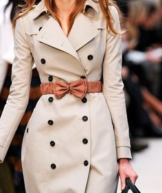 Luxury of the Day 4-23-13 // Burberry Trench Coat. The belt helps to accentuate the waist into an hour glass figure.