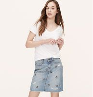"""Jeweled Denim Skirt in Horizon Blue Wash - To dazzle this forever favorite, we gave it a lightly destructed, sea-meets-sky hue – and jeweled things up for sparkling allure. Zip fly with button closure. Belt loops. Five-pocket styling. 18"""" long."""