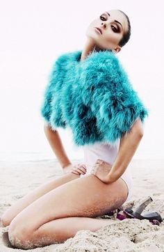 I hate when I fall on the beach in my heels and feather cover-up. lol