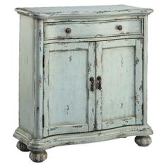A cottage-chic addition to your living room or master suite, this hand-painted cabinet showcases weathered details in robin's egg blue.