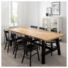IKEA - SKOGSTA, Dining table, Every table is unique, with varying grain pattern and natural color shifts that are part of the charm of wood.Solid wood is a durable natural material which can be sanded and surface treated when required. Ikea Dining Room, Dining Table Chairs, Dining Set, Ikea Dining Table Hack, Narrow Dining Room Table, Butcher Block Dining Table, Farmhouse Dining Tables, 12 Person Dining Table, Modern Rustic Dining Table