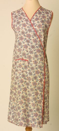 "Apron, made by Hercules, England: 1930-1935, floral-printed cotton. Woven Label Center Back Neck: ""The Beech Tree brand, a guaranteed garment"""