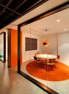 Fun concept for meeting room. can be pitchen green color, the doors green glass. Round meeting table orange circle black frame partition Source by kevinhird Cool Office Space, Office Space Design, Modern Office Design, Office Workspace, Office Interior Design, Desk Space, Office Spaces, Small Office, Office Cube