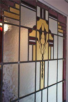 Detail van een glas in lood deur