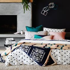 SAGE & CLARE Hand printed tribal and dot pattern reversible quilt cover in navy and blush pink