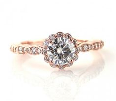 14K rose gold ring with moissanite solitaire and side diamonds by Rare Earth (Etsy). $1116 Cdn.