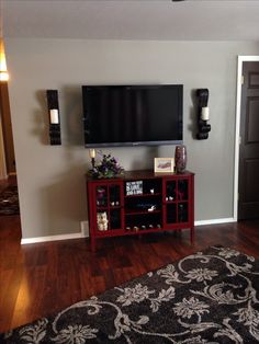 """Love my TV wall!!! 46"""" tv , wall mounted, all hidden cables and components. Cabinet from Walmart.  http://mobile.walmart.com/m/phoenix#ip/-Spring-Street-Hinsdale-2-Door-with-Center-Shelves-Console-Cabinet-Red/26893667?type=search"""