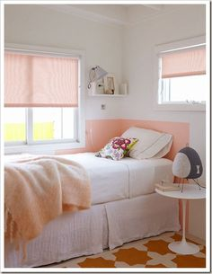 Pink & white girl's bedroom design with pink roller shades, pink painted headboard, crisp white bedding & bed skirt, white saarinen accent table, pink wool throw and ivory & orange rug. Girl Bedroom Designs, Girls Bedroom, Bedroom Decor, Bedroom Ideas, Pale Pink Bedrooms, Peach Bedroom, Coral Bedroom, Pink Room, Small Bedrooms