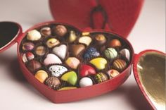A box full of chocolates, which each chocolate piece remind me of a jewel.