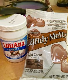 Use coconut oil to thin Wilton's candy melts. Nice creamy chocolate with no icky taste like shortening leaves behind!