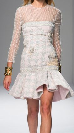 Balmain at PFW Spring 2014. The skirts in this line remind me of vintage Chanel