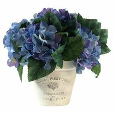 "Silk hydrangea arrangement in a clay pot.Product: Faux floral arrangementConstruction Material: Silk, plastic and clayColor: Purple, green and whiteFeatures: Includes faux hydrangeasDimensions: 11"" H x 11"" Diameter"
