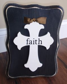 "Wood Cross Plaque with Creamy Cross, Black ""faith"" vinyl lettering, Coffee Ribbon & Weathered Distressed Black Scalloped Wood Plaque. $17.00, via Etsy."