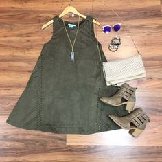 Make a statement in this olive #suede swing dress! It is so lightweight and comfortable, and perfect for #fall! Throw on your favorite pair of #booties and you'll be good to go