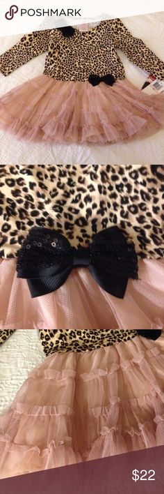 New little leopard tulle dress! Little black sequence bows, leopard print design on top with a tulle and lace design on the bottom! Forgot I had this hanging in my daughters closet and she has now outgrown! New with tags! I also have another closet that will eventually be for only boutique items but I have so many gorgeous used and new childrens items listed there that I will be adding to this closet, check out @trendsetterdiva Nannette Dresses