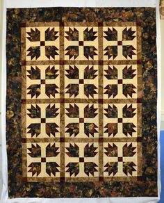 "We have the PERFECT quilt for the special guys in your life! Starting with QP Quilts & Co.'s ""Bear's Paw"", create a cozy, autumn-y quilt with gorgeous, bear paw-filled batiks. Finish it off with a coordinating bear-y batik for backing and you'll have yourself one fine ""dude"" quilt! >> pattern: $5.99 >>fabric kit for lap-sized quilt: $73.99"