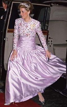 Designed by Catherine Walker. Lilac bodice and bolero jacket embroidered with violets and roses and adorned with beads. Diana wore this creation in Kuwait in 1989 , again in 1989 to a banquet at Claridges's for the President of Nigeria. She had it altered in 1992 when she wore it to a gala celebrating the 40th Anniversary of the Queen's reign. $51,750.00