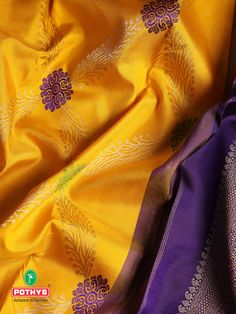 The color of the sun yellow that is perfectly blended with the contrast purple border and pallu with delicate and spectacular embroidery of purple threads adds a grace-giving the celebration for this festival season. #silksaree #puresilk #saree #traditionalsaree #sareedesigns #sareestyles #weddingsaree #sareelook #diwali #bridalsaree #sareeembroidery #diwalispecial #diwalicollection #softsilksaree #silksareeblouse #weddingsilks #kancheepuramsilk #weddingblouse #southindianwedding #pothys