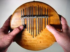 Thumb Piano Make The thumb piano known as a kalimba mbira and by many other names is a lamellaphone that uses prongs called tongues keys or tines that you pluck to gen. Diy Furniture Book, Homemade Musical Instruments, Music Instruments, Kalimba, Guitar For Beginners, Piano Sheet Music, E Learning, Folded Up, Crafts To Do