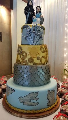 Game of thrones wedding cake with custom made edible mini me topper Jon snow and Daenery inspired