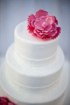 Very simple w/ a pop of color -- of course that would depend on the flowers selected for the rest of the wedding & colors
