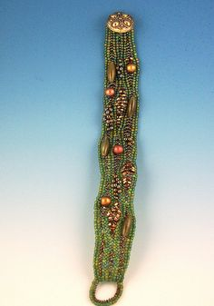Green Herringbone Bracelet by ambrosianbeads, via Flickr