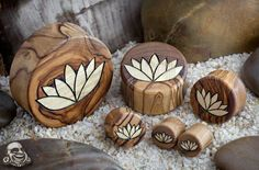 """Olivewood plugs with lotus flower inlays from Bodyartforms.com. Size 5/8"""" or 16 mm."""
