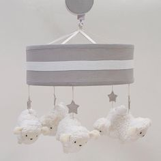 "Five adorable little sheep slowly turn to the music of Brahms' Lullaby.  Measures 10.5"" x 10"". Contains a coordinated cover for the mobile arm, and safely fits all standard and most convertible cribs. An optional wall mount is included to provide placement options. Easy to follow assembly instructions are included."