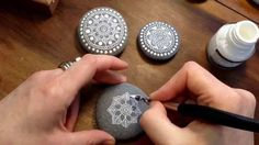 Mandala Painted Pebble video.  White ink and caligraphy pen.