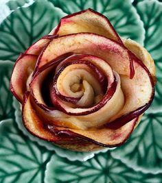 You'll want to stop and smell your freshly baked apple roses. The apple's rich red peel is what makes them look like roses. Apple Roses Makes 2 servings 4 tablespoons butter, melted 1 teaspoon cinnamon ½ cup sugar, plus more for preparing the ramekins 1 apple 1 sheet of frozen puff pastry (thawed slightly) 1 beaten egg Confectioner's sugar