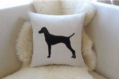 This hand-cut pillow cover is one dog that's always allowed on the couch. The sleek silhouette—available in a variety of breeds—is appliquéd on a textured cotton white or beige pillow cover and designed to fit an 18 x 18-inch form.  ($48, vixengoods.etsy.com)   - CountryLiving.com