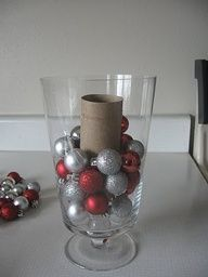Remember to use a toilet paper roll as a filler- makes ornaments go further in filling vases! smart!! -- Could be cute wrapped in wrapping paper and filled with clear/glitter balls, too.