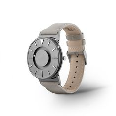 The minimalist face of The Bradley Canvas features raised hour markers brushed in a smooth mirrored finish. The pure titanium case body adds an air of elegance and durability to the piece. Available i