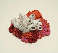 Helle Jorgensen crochets plastic bags she recovers from the beaches into beautiful art and jewelry pieces. Really cool!