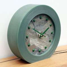 Ocean Slate Mantel Clock in a Green Frame with Dark Green Studs and Hands