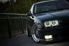 Very nice photo of an also very nice BMW e36 sedan sitting on culture classic BBS RS wheels