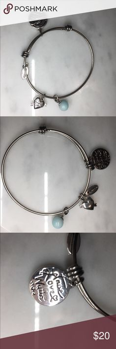 NWOT medallion with True Love Waits on both sides True Love Waits written on both sides of the medallion and there is a puffed heart that has an arrow going though it and the letters T L W. there is a light blue real stone ball. Unwritten Jewelry Bracelets