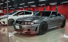 The Nismo Omori Factory In Japan Is The Ultimate Nissan Candy Store Skyline R33, Nissan Skyline, Nissan R33, Animation Reference, Candy Store, Sexy Cars, Godzilla, Jdm, Culture