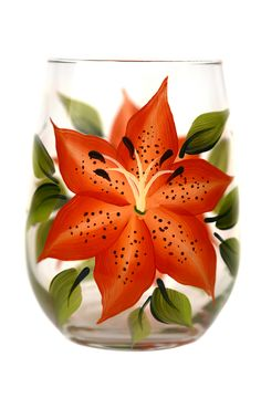 Vivid orange tigerlily petals with soft yellow highlights and brown speckling and deep green leaves hand-painted encircling a quality 17 oz stemless wine glass. Sealed and heat-cured for added durabil