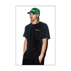 Highsnobiety  This is from the OVO look book.  OVO is a brand created by rapper Drake.  The model is wearing a velvet black shirt.  Velvet is one the trendiest fabrics right now.  For a guy to pull it off with an unexpected green cap is cool.