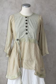 something similar (but shorter) could also be blouse to go with skirt